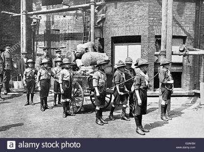 London scouts moving goods from barracks to station. 1914.